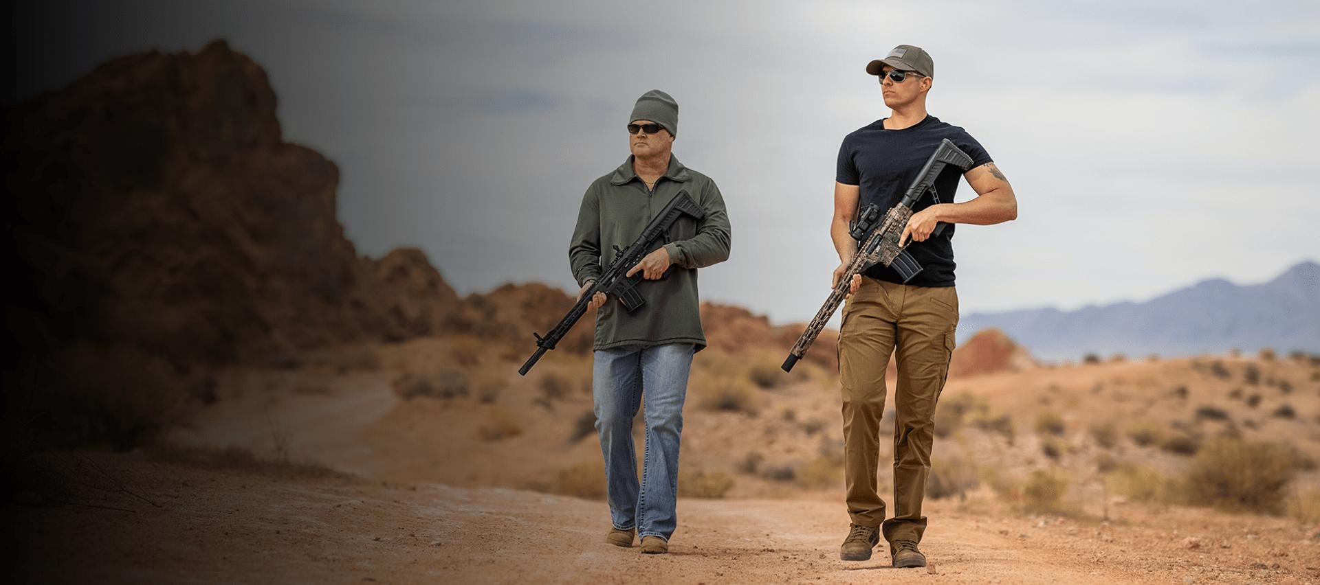 Men holding VR82 in desert